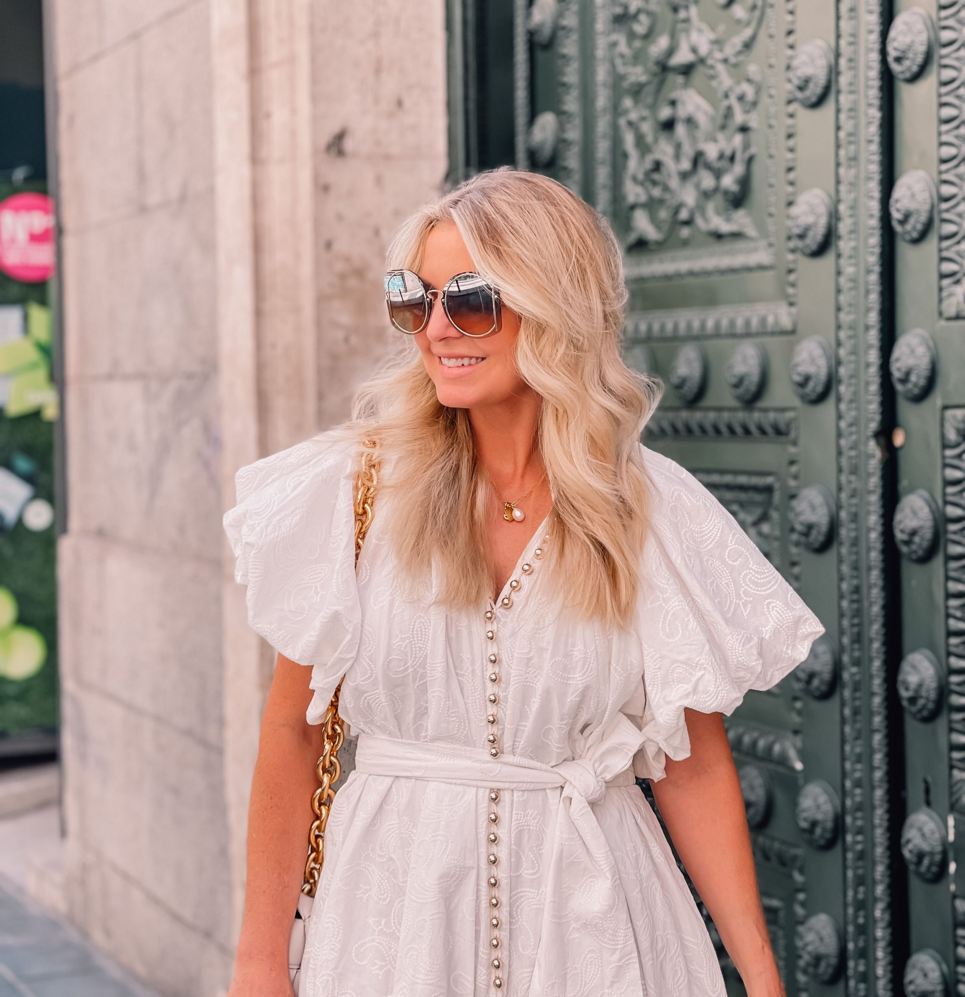 white dress by Acler with puff sleeves on fashion over 40 blogger Erin Busbee in Madrid Spain